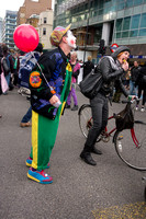 Clown and cyclist, London, UK